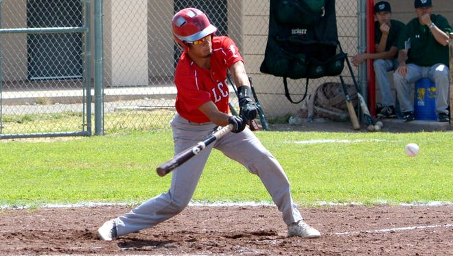 Loving's Joel Hernandez swings at a pitch in game one Saturday against Texico.