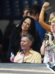 Randy Travis and wife Mary Davis listen to the Brothers