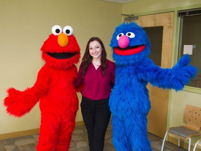 Elmo, Rachel Dresner (performance director), Grover.