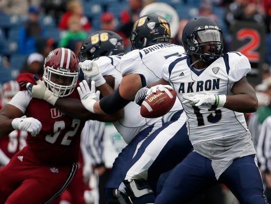Akron quarterback Thomas Woodson (13), a four-year