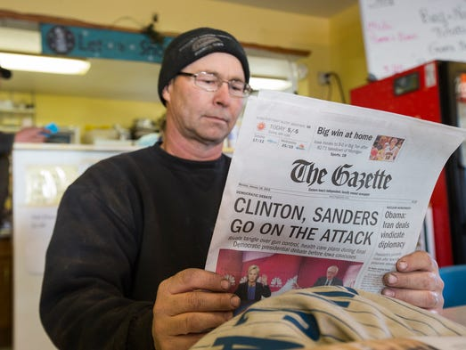 Dave Buchholtz reads a copy of the newspaper at the