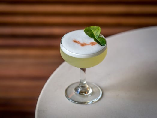 The handsome bar serves up seasonal cocktails like The Slip, made with ...