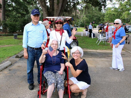 Candace with her mother and Sparkler Volunteers, Drs. Ping and Peggy Hsieh, at the Westminster Oaks July Fourth Parade.