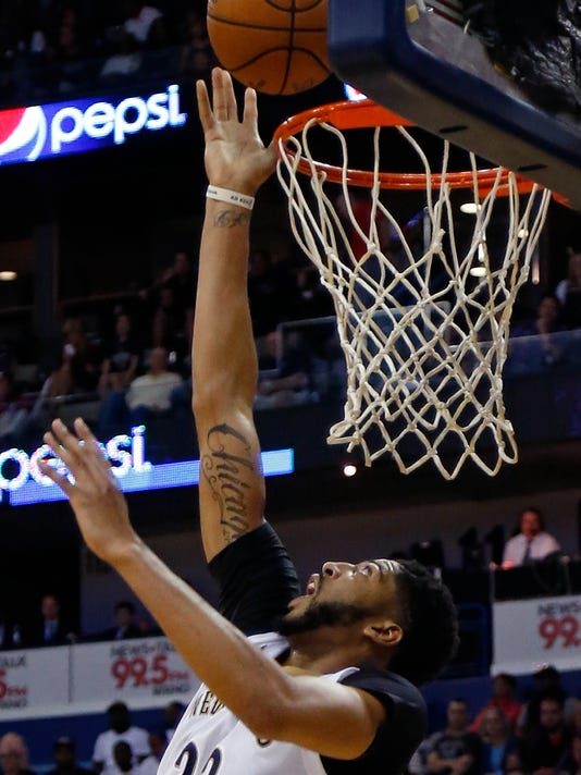 New Orleans Pelicans forward Anthony Davis shoots against the Golden State Warriors during the second half of an NBA basketball game in New Orleans, Friday, Oct. 28, 2016. The Warriors won 122-114. (AP Photo/Max Becherer)