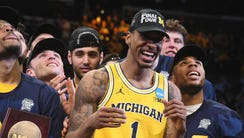 Michigan Wolverines guard Charles Matthews celebrates