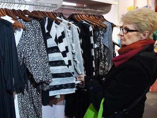 Donna Madara of Lewes shops for dresses in downtown