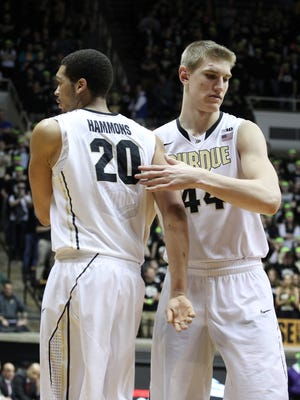 Purdue Boilermakers center Isaac Haas, right, checks into the game for center A.J. Hammons against the Rutgers Scarlet Knights.