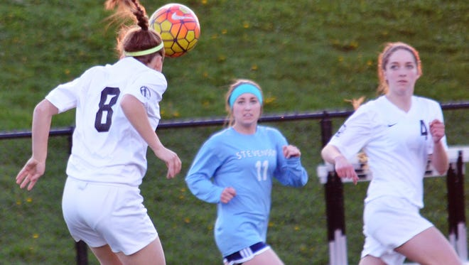 One of Livonia Stevenson's key returners is Alyssa Benvenuti (center), shown during a 2016 game against South Lyon East.