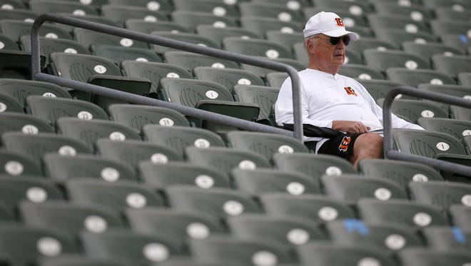 Cincinnati Bengals owner Mike Brown watches practice from the stands during the team's mini camp inside Paul Brown Stadium in downtown Cincinnati on Wednesday, June 14, 2017.