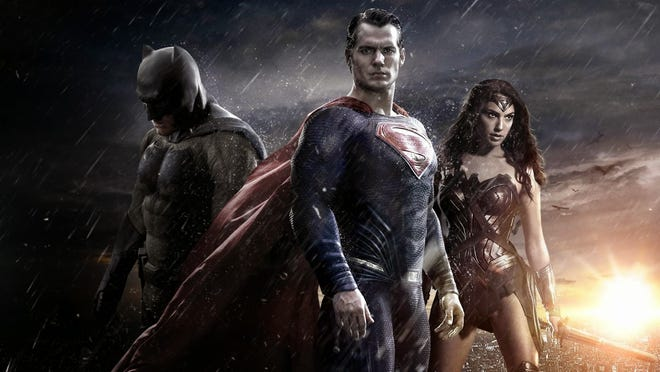 """Batman (Ben Affleck), left, Superman (Henry Cavill) and Wonder Woman (Gal Gadot) star in """"Batman v Superman: Dawn of Justice."""" Despite its box-office success, the film has a 27 percent rating on the movie review site Rotten Tomatoes."""