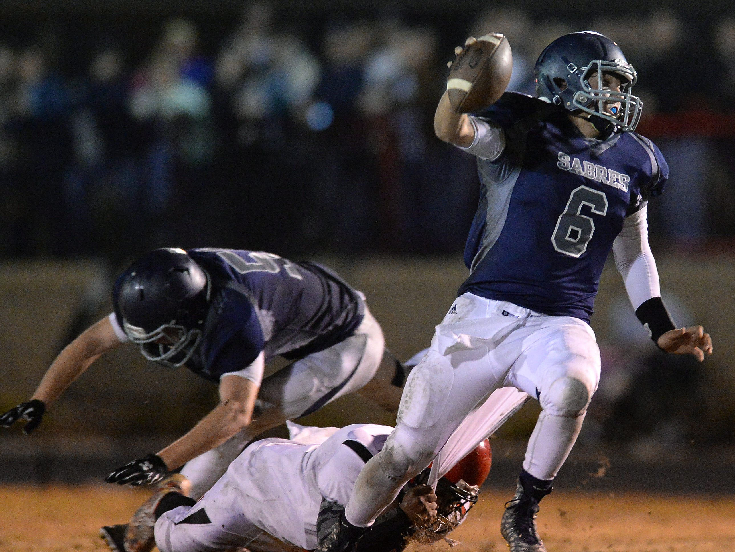 Southside Christian quarterback Clayton Coulter (6) scrambles past McBee's Quentin Tedder (15) during the Class A Division I playoffs Friday, November 27, 2015.