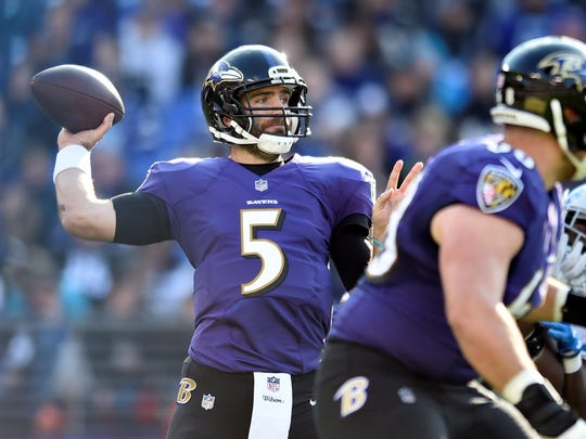 Baltimore Ravens quarterback Joe Flacco throws to a receiver in the first half of an NFL football game against the Detroit Lions, Sunday, Dec. 3, 2017, in Baltimore.