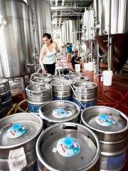 Sarah Gulotta fills kegs at Hi-Wire Brewing June 23.
