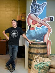 Bill Tanner, owner of PennyCup Coffee Co., stands with