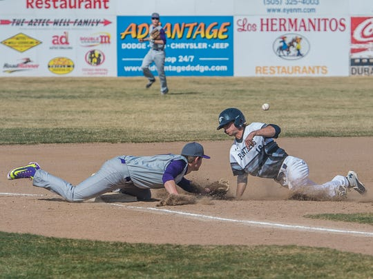 Piedra Vista's Kyle DeWees slides safely into third base during a game against Littleton, Colo., on Friday at Ricketts Park in Farmington.