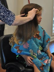 Reagan Sweat, 4, before his first haircut at My Legacy Salon in Alexandria on Thursday.