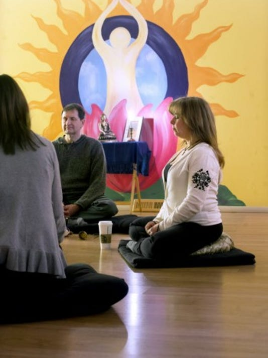 If you're feeling more stressed, consider these tips from Dr. Edward Rogers.  From the left, Lisa Stambaugh, of York Township, Bob Hayes of Renaissance Yoga in York Township and Laura Sharp of Spring Garden Township meditate.  (Daily Record/Sunday News -- Paul Kuehnel)