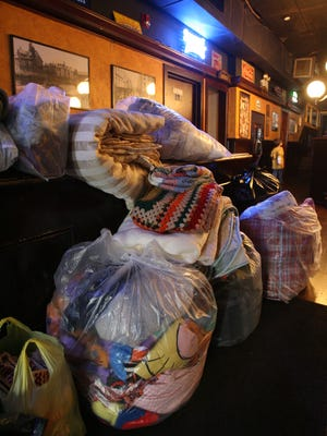 (file photo) Donated blankets are piled up during Blank-Fest at Bruxelles in Nyack in 2010.