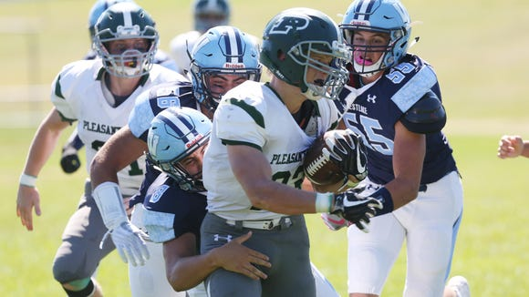 Pleasantville's Charlie McPhee (23) runs for a big