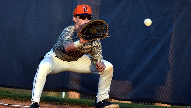Beech first baseman Drew Robertson receives a throw during Tuesday's 6-3 victory over Hendersonville. Robertson went 2-for-3 with two runs batted in.