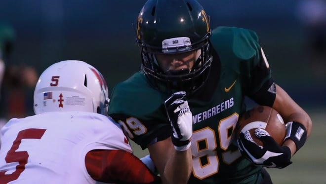 Austin Hargraves, right, and the D.C. Everest football team take a five-game winning streak to Kimberly this week.
