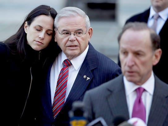 U.S. Sen. Bob Menendez, center, stands with his daughter,