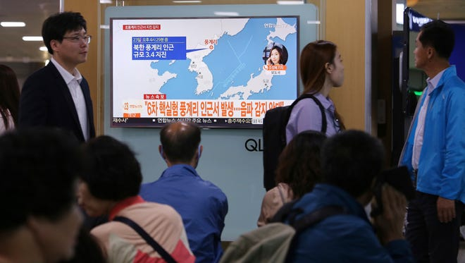 People watch a TV news program reporting North Korea's earthquake, at Seoul Railway Station in Seoul, South Korea, Sept. 23, 2017.