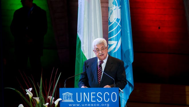Palestinian President Mahmoud Abbas delivers a speech after a flag raising ceremony of the Palestinian flag at UNESCO Headquarters in Paris, in 2011