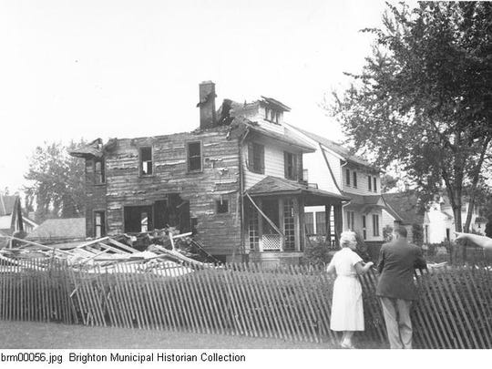 People look at a house on Fair Oaks Avenue damaged as part of the series of gas explosions on Sept. 21, 1951.