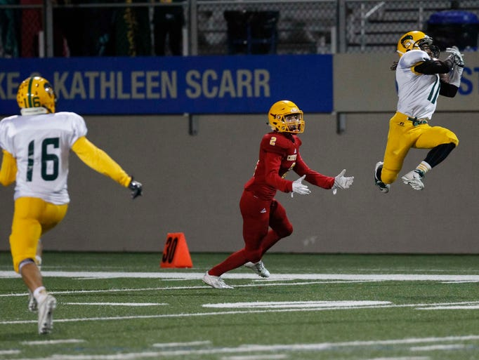 Live Oak's Christian Guary breaks up a pass intended