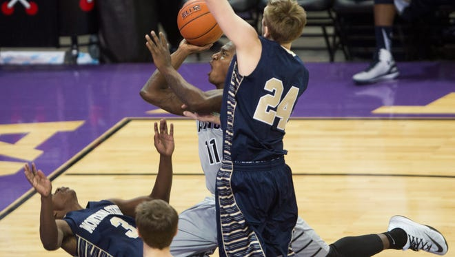 GCU's De'Andre Davis (11) draws a blocking foul on Montana State's Michael Dison (3) as Eric Norman (24) goes up for a block at Grand Canyon University in Phoenix on Nov. 17, 2014.