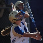 Reed's Julia Jensen watches her towering sacrifice fly in the first inning against Damonte Ranch on Thursday.