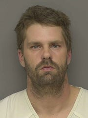 Kenneth James Smith, 39, of Flint, is charged with