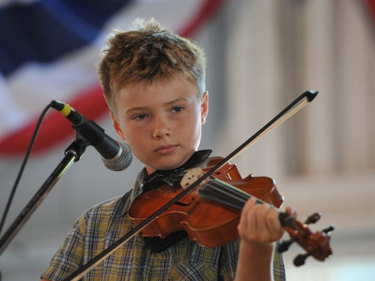 Twelve year old Sam Alexander, of Indianola, participates in the Fiddler's Contests at the Iowa State Fair on Aug. 11.