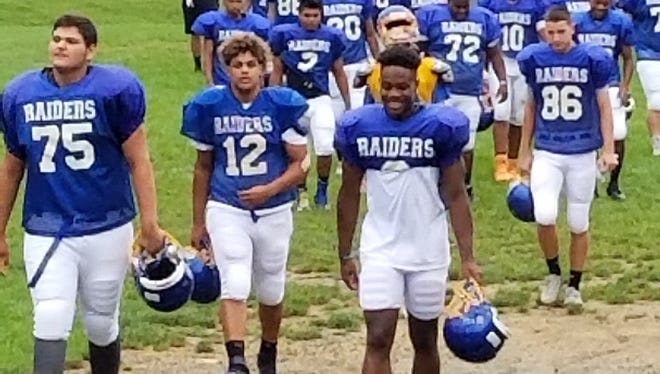 North Brunswick football players head to the field for Tuesday's practice
