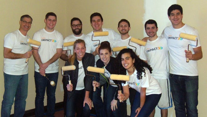 Volunteers from Insight Venture Partners who helped paint the Chapel at St. Christopher's Inc, a Dobbs Ferry agency for special needs children and their families. From left in the back row are Gary Survis, Joshua Zelman, Matthew Lefkowitz, Byron Lichtenstein, Barak Kaufman, David Spiro and Sam Rosen In the front row are Philine Huizing, Ryley Reynolds and Mikenzie Ginsberg.
