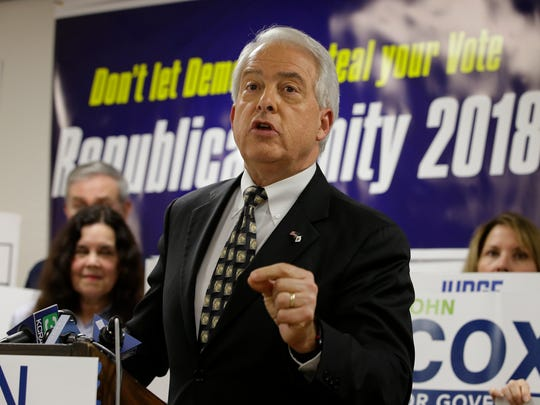 FILE - In this May 23, 2018, file photo, Republican gubernatorial candidate John Cox address supporters at the Sacramento County Republican Party headquarters in Sacramento, Calif. Tuesday's primary election will set the stage for November races for governor, Congress and the Legislature, but it will also test whether the state's vanishing Republicans have enough remaining influence to avoid another shutout at the statewide polls. Cox has the backing of President Donald Trump in his bid to qualify for a two-person runoff this fall. (AP Photo/Rich Pedroncelli, File)