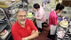 Ken Jarosch, owner of Jarosch Bakery, poses for a portrait