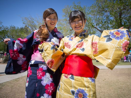 Manami Ishikawa and Sakina Shirai from Japan pose for the camera during the Las Cruces International Festival at Pioneer Women's Park, April 2, 2016.