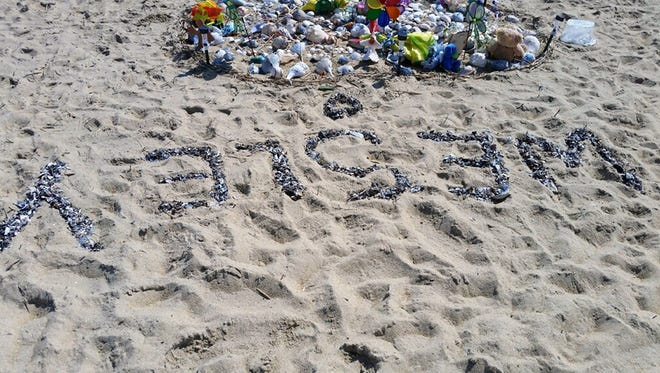 Mourners on the beach in Kitty Hawk, N.C., created this memorial to Wesley Belisle, 4, of Manchester, N.H., after the boy was swept out to sea April 25, 2018, when a wave knocked him and his mother over as they walked along the seashore.