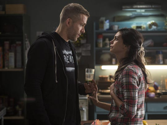"""Ryan Reynolds and Morena Baccarin star in """"Deadpool."""""""
