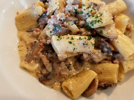 Rigatoni with mushroom cream sauce, thyme, sausage and parmesan cheese at Convivio Italian restaurant in Carmel.