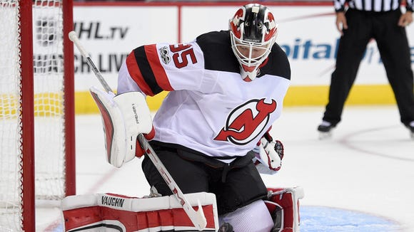 New Jersey Devils goalie Cory Schneider (35) watches the puck during the second period of an NHL preseason hockey game against the Washington Capitals, Wednesday, Sept. 27, 2017, in Washington. (AP Photo/Nick Wass)