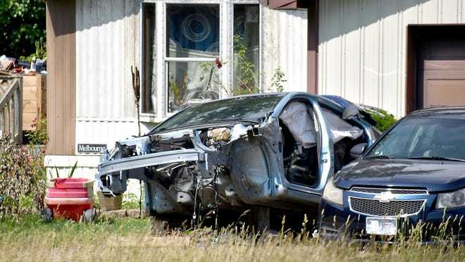 The remains of a car sits outside of a Southern Road home, in violation of the Kinderhook zoning ordiances.