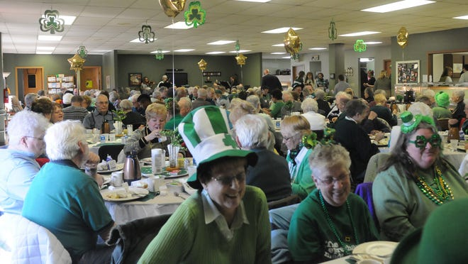 Senior citizens engaged in upbeat events such as the community St. Patrick's Day celebration at the ADRC/Senior and Community Center.