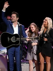 "Charles Esten, Maisy Stella and Lennon Stella participate in the final U.S. performance by the cast of the TV show ""Nashville"" on March 25, 2018, at the Grand Ole Opry."