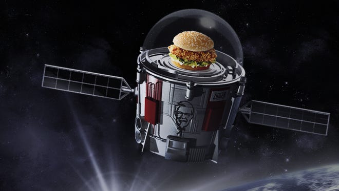"""Poster promoting KFC's launch of a Zinger chicken sandwich to the edge of space in a """"bucket satellite."""""""