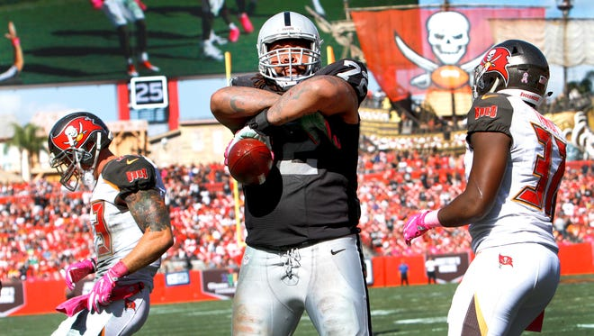 Tackle Donald Penn of the Oakland Raiders stares into the stands after catching a touchdown pass in the third quarter against the Tampa Bay Buccaneers to tie the game at 10-10 at Raymond James Stadium on October 30, 2016 in Tampa, Florida.
