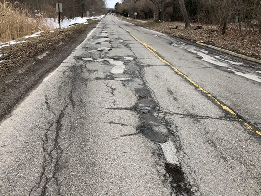 Potholes on Lone Pine near Fairway Ridge in West Bloomfield on March 15, 2018.