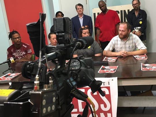 Josh Spring, executive director of the Greater Cincinnati Homeless Coalition, speaks at a news conference Wednesday afternoon in response to Prosecutor Joe Deters' decision to evict homeless camp residents from 13th and Republic streets.